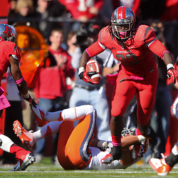 Oct 13, 2012: Rutgers Scarlet Knights linebacker Khaseem Greene (20) returns an interception during NCAA Big East college football action between the Rutgers Scarlet Knights and Syracuse Orange at High Point Solutions Stadium in Piscataway, N.J.