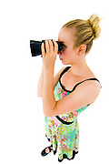 Young blond woman with binoculars - exaggerated viewing angle