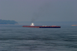 25 July 2005.  Tug and Barge traffic on the Mississippi River near the Tunica River Park.  The day was unusually hot and humid with a thick haze hanging in the 98 degree sky - at mid day.