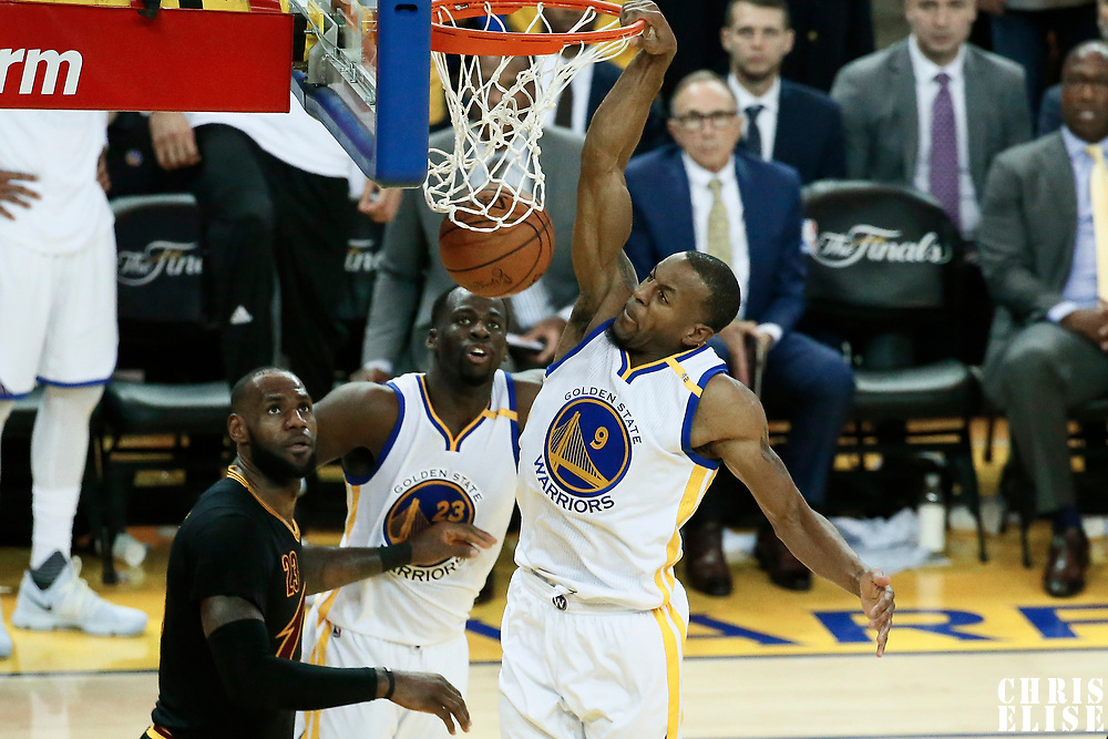 12 June 2017: Golden State Warriors forward Andre Iguodala (9) dunks the ball during the Golden State Warriors 129-120 victory over the Cleveland Cavaliers, in game 5 of the 2017 NBA Finals, at the Oracle Arena, Oakland, California, USA.