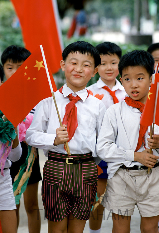 Schoolchildren with Chinese flags at  Xian, China in the 1980s