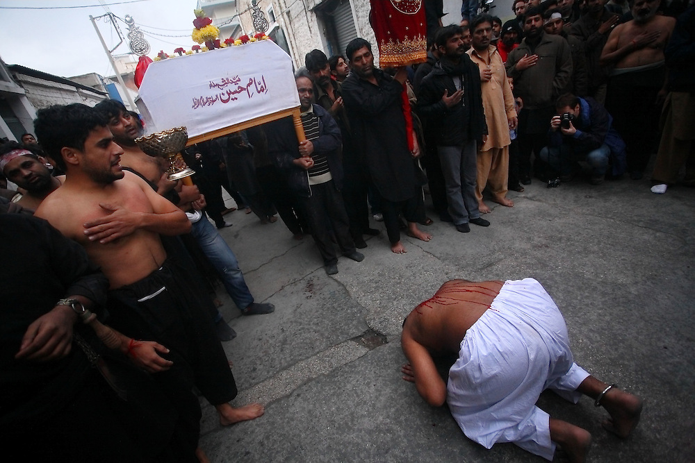 Ritualistic self flagellation during the Ashura Festival. The day of Ashura, December 16th 2010. Shia Muslims in Athens are mourning in commemoration of the martyrdom of Imam Hussein, the grandson of the Prophet Muhammad, and 72 of his companions and family members in Karbala, Iraq, over 1,300 years ago while fighting for justice.