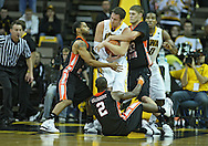 December 04 2010: Iowa Hawkeyes forward Andrew Brommer (20) tries to hang onto the ball as Idaho State Bengals guard Phyllip Taylor (3) and center Deividas Busma (33) try to grab it during the second half of their NCAA basketball game at Carver-Hawkeye Arena in Iowa City, Iowa on December 4, 2010. Iowa won 70-53.