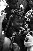 Woman smiling at the camera at Notting Hill Carnival, 1995.
