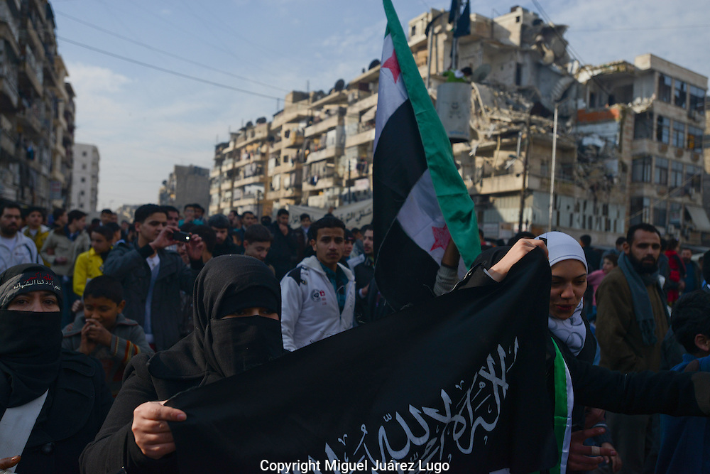 Aleppo, Syria, December, 2012 - In a rare show of political participation, conservative Muslim women hold the flag of jihad at a rally in support of the Free Syrian Army in the streets of this city. (Photo by Miguel Juárez Lugo)
