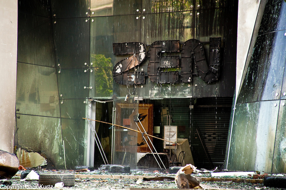 20 MAY 2010 - BANGKOK, THAILAND: The main entrance to the Zen department store in Central World, the second largest shopping mall in southeast Asia, was destroyed by arsonist working with the anti government Red Shirts in the Ratchaprasong Intersection in Bangkok Thursday. The day after a military crackdown killed at least six people, Thai authorities continued mopping up operations around the site of the Red Shirt rally stage and battle fires set by Red Shirt supporters in the luxury malls around the intersection. Anti government forces set fire to the mall and several other locations across Bangkok after their leaders surrendered to police.   PHOTO BY JACK KURTZ