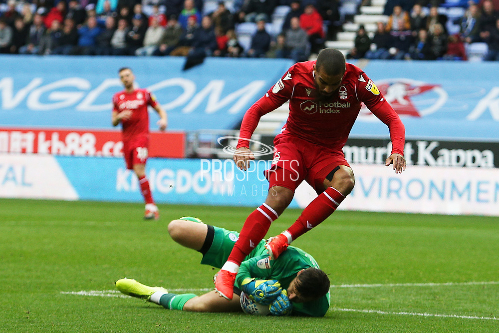 Wigan Athletic goalkeeper David Marshall (1) dives at the feet of Nottingham Forest forward Lewis Grabban (7) to collect the  ball  during the EFL Sky Bet Championship match between Wigan Athletic and Nottingham Forest at the DW Stadium, Wigan, England on 20 October 2019.