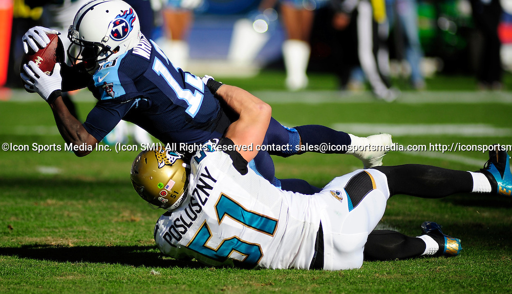 Nov. 10, 2013 - Nashville, TN, USA - Tennessee Titans wide receiver Kendall Wright (13) is tackled by Jacksonville Jaguars middle linebacker Paul Posluszny (51) during 2nd half action at LP Field in Nashville, Tn