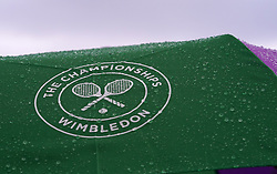A detailed view of a Wimbledon umbrella on day three of the Wimbledon Championships at the All England Lawn Tennis and Croquet Club, Wimbledon. PRESS ASSOCIATION Photo. Picture date: Wednesday July 4, 2018. See PA story TENNIS Wimbledon. Photo credit should read: John Walton/PA Wire. RESTRICTIONS: Editorial use only. No commercial use without prior written consent of the AELTC. Still image use only - no moving images to emulate broadcast. No superimposing or removal of sponsor/ad logos. Call +44 (0)1158 447447 for further information.