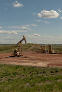 Bakken Oil Fields, oil well, still active after bust, west of Cartwright North Dakota