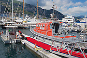 MONACO, MONACO - JUNE 17, 2015: Red police boat tied at the harbor in Monaco.