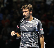 Switzerland's Stan Wawrinka clinches the first set during the Semi Final of Barclays ATP World Tour 2014 between Switzerland's Roger Federer and Switzerland's Stan Wawrinka, O2 Arena, London, United Kingdom on 15th November 2014 © Pro Sports Images