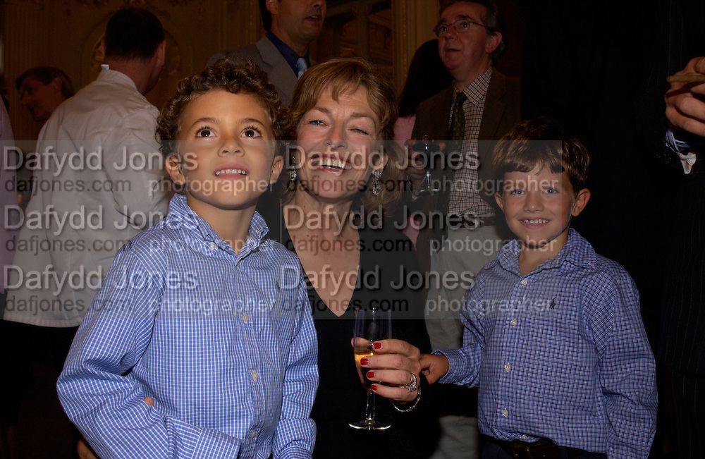 Flora Fraser with her sons Simon and Tommy Soros, Flora Fraser launch party for her book ' Princesses the Daughters of George 111' the Savile club, Brook St. 14 September 2004. SUPPLIED FOR ONE-TIME USE ONLY-DO NOT ARCHIVE. © Copyright Photograph by Dafydd Jones 66 Stockwell Park Rd. London SW9 0DA Tel 020 7733 0108 www.dafjones.com