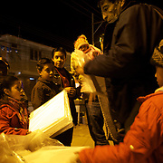 'Attitude at Altitude' Football in Potosi, Bolivia'..Youngsters sell polystyrene seating for one Boliviano (20c) during a night match between Real Potosi and Universitario Sucre at the Estadio Victor Agustin Ugarte, home of Bolivian football team Real Potosi. Real Potosi won the match 4-3. Potosi, Bolivia, 12th May 2010. Photo Tim Clayton....'Attitude at Altitude' Football in Potosi, Bolivia'..The Calvario players greet the final whistle with joyous celebration, high fives and bear hugs the players are sprayed with local Potosina beer after a monumental 3-1 victory over arch rivals Galpes S.C. in the Liga Deportiva San Cristobal. The Cup Final, high in the hills over Potosi. Bolivia, is a scene familiar to many small local football leagues around the world, only this time the game isn't played on grass but a rock hard earth pitch amongst gravel and boulders and white lines that are as straight as a witches nose, The hard surface resembles the earth from Cerro Rico the huge mountain that overlooks the town. .. Sitting at 4,090M (13,420 Feet) above sea level the small mining community of Potosi, Bolivia is one of the highest cities in the world by elevation and sits 'sky high' in the hills of the land locked nation. ..Overlooking the city is the infamous mountain, Cerro Rico (rich mountain), a mountain conceived to be made of silver ore. It was the major supplier of silver for the spanish empire and has been mined since 1546, according to records 45,000 tons of pure silver were mined from Cerro Rico between 1556 and 1783, 9000 tons of which went to the Spanish Monarchy. The mountain produced fabulous wealth and became one of the largest and wealthiest cities in Latin America. The Extraordinary riches of Potosi were featured in Maguel de Cervantes famous novel 'Don Quixote'. One theory holds that the mint mark of Potosi, the letters PTSI superimposed on one another is the origin of the dollar sign...Today mainly zinc, lead, tin and small quantities of silver are extrac