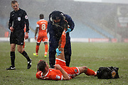 Shrewsbury Town midfielder Ben Godfrey (4) received treatment during the EFL Sky Bet League 1 match between Scunthorpe United and Shrewsbury Town at Glanford Park, Scunthorpe, England on 17 March 2018. Picture by Mick Atkins.