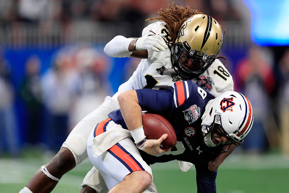 Auburn Tigers quarterback Jarrett Stidham (8) is sacked by UCF Knights linebacker Shaquem Griffin (18) during the 2018 Chick-fil-A Peach Bowl NCAA football game on Monday, January 1, 2018 in Atlanta. (Paul Abell / Abell Images for the Chick-fil-A Peach Bowl)