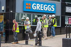 © Licensed to London News Pictures. 18/06/2020. Leeds UK. Builders queue outside a Greggs shop in Leeds city centre this morning as the store opens shops across the UK after the Covid-19 lockdown. Photo credit: Andrew McCaren/LNP