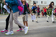 Students are released from Sam Tasby Middle School with Ebola informational handouts in Dallas, Texas on October 2, 2014 where officials confirmed that a student had come in contact with Thomas E. Duncan, the first confirmed Ebola virus patient in the United States.