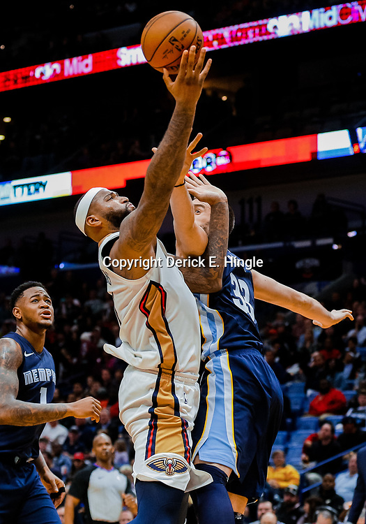 Jan 20, 2018; New Orleans, LA, USA; New Orleans Pelicans center DeMarcus Cousins (0) shoots over Memphis Grizzlies center Marc Gasol (33) during the second half at the Smoothie King Center. The Pelicans defeated the Grizzlies 111-104. Mandatory Credit: Derick E. Hingle-USA TODAY Sports