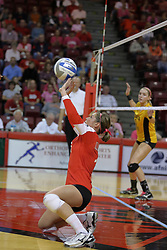 23 October 2010: Kristin Stauter sets the ball while on a knee during an NCAA, Missouri Valley Conference volleyball match between the Wichita State Shockers and the Illinois State Redbirds at Redbird Arena in Normal Illinois.