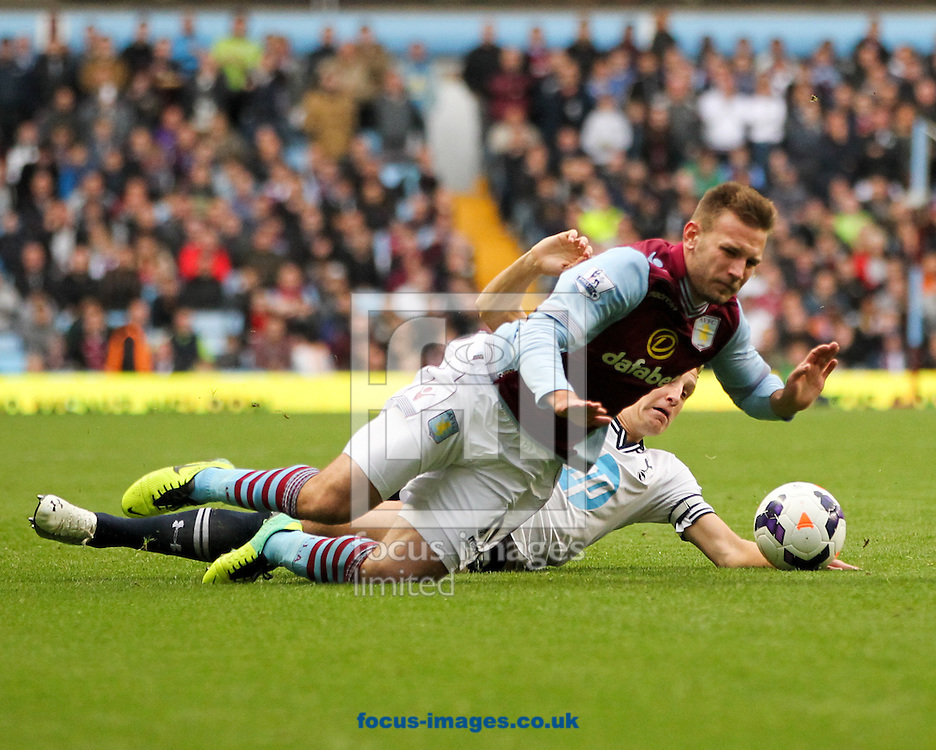 Picture by Tom Smith/Focus Images Ltd 07545141164<br /> 20/10/2013<br /> Andreas Weimann (front) of Aston Villa is fouled by Michael Dawson (back) of Tottenham Hotspur during the Barclays Premier League match at Villa Park, Birmingham.