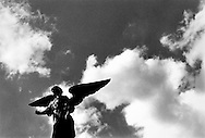 Coming to Earth. Angel sculpture in Central Park, New York City. 1988.