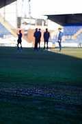 Wimbledon players inspecting the muddy pitch during the EFL Sky Bet League 1 match between Tranmere Rovers and AFC Wimbledon at Prenton Park, Birkenhead, England on 21 December 2019.