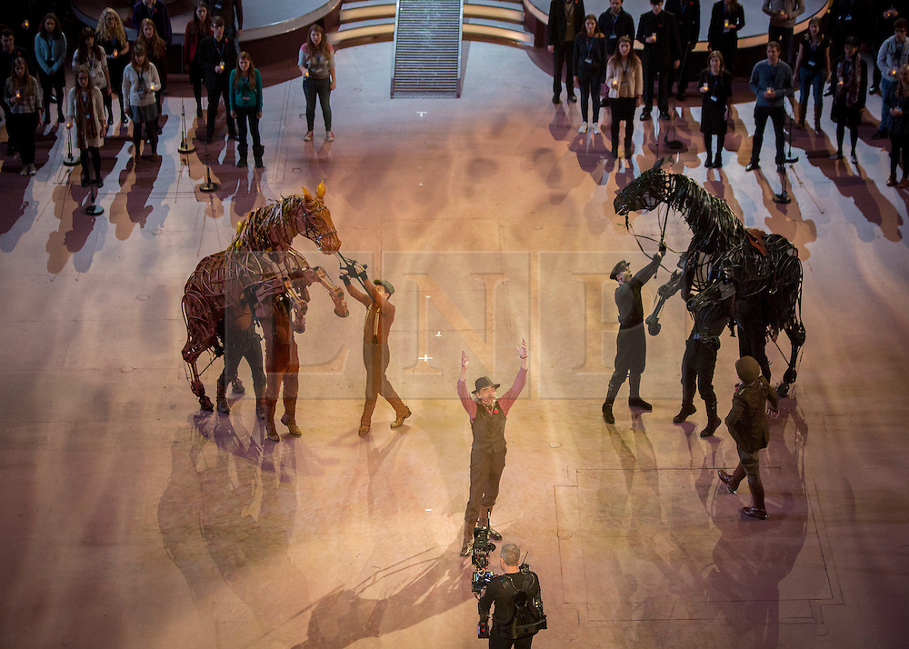 © Licensed to London News Pictures. 07/11/2014.  London.  Cast from the War Horse along with singer John Tams  rehearse in the arena of the Royal Albert Hall ahead of their performance at today's Festival of Remembrance.  First broadcast in 1927 the festival has now been held in the Royal Albert Hall for 87 years.  Photo credit : Alison Baskerville/LNP