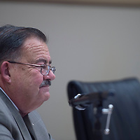 Board member Joe Menini votes against moving forward with a revised agenda but is overruled by other members during the Gallup McKinley County school board meeting in Gallup Monday.
