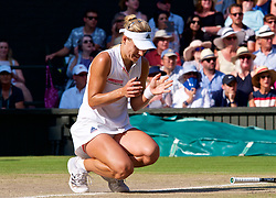 LONDON, ENGLAND - Saturday, July 14, 2018: Angelique Kerber (GER) collapses to her knees as she celebrates winning the Ladies' Singles Final match 6-3, 6-3 on day twelve of the Wimbledon Lawn Tennis Championships at the All England Lawn Tennis and Croquet Club. (Pic by Kirsten Holst/Propaganda)