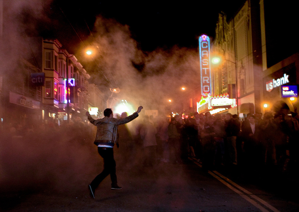 A crowd gathered on Castro Street and watched as an effigy of George W. Bush is burned just after  Barack Obama wins the Presidency on election night in San Francisco, California on November 4, 2008. Photo by Deanne Fitzmaurice
