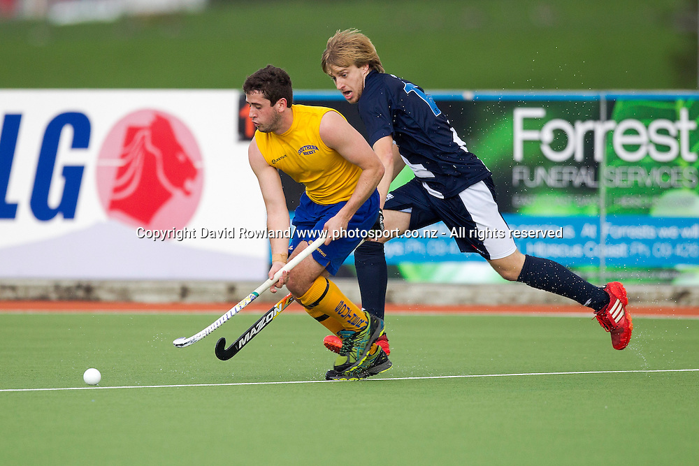 Southern`s Nick Elder  is challenged by Auckland`s Ben Radonovich in the Auckland v Southern Men`s semi-final match, Ford National Hockey League, North Harbour Hockey Stadium, Auckland, New Zealand,Saturday, September 13, 2014. Photo: David Rowland/Photosport