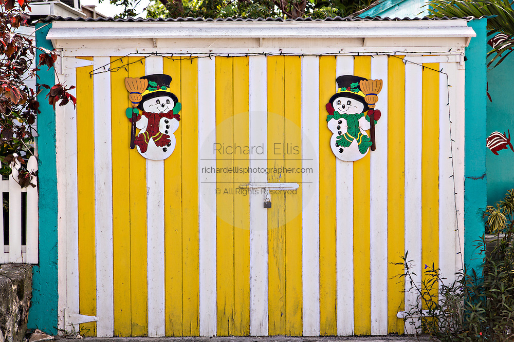 Christmas decorations on a colorful wall in Dunmore Town, Harbour Island, The Bahamas