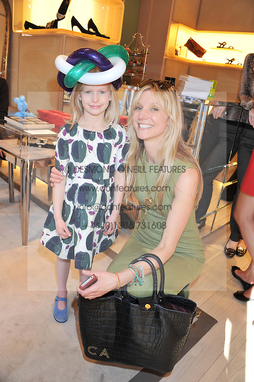 CALGARY AVANSINO and her daughter AVA at a fun filled tea party hosted by Roger Vivier to view their Jeune Fille collection of shoes in aid of Mothers4Children held at Roger Vivier, Sloane Street, London on 27th March 2012.