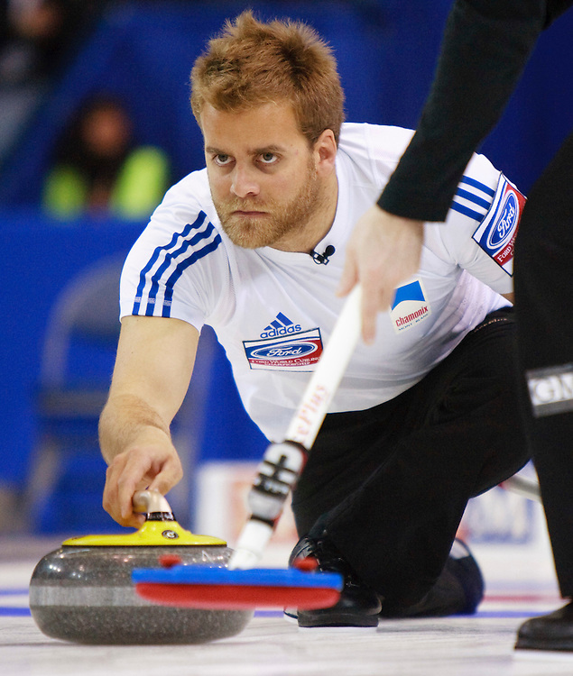 France's third, Tony Angiboust, delivers a rock during Drance's game against the United States during the evening draw at the Ford World Men's Curling Championships at the Brandt Centre in Regina, Saskatchewan, April 7, 2011.<br /> AFP PHOTO/Geoff Robins