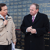 Quilty man and recent Clare man of the year, Marty Morrissey, with An tUachtaran Cumann Luthchleas Gael, Mr. Liam O'Neill, opening the centenary wall during the Kilmurry Ibrickane GAA Club Centenary Closing Ceremony