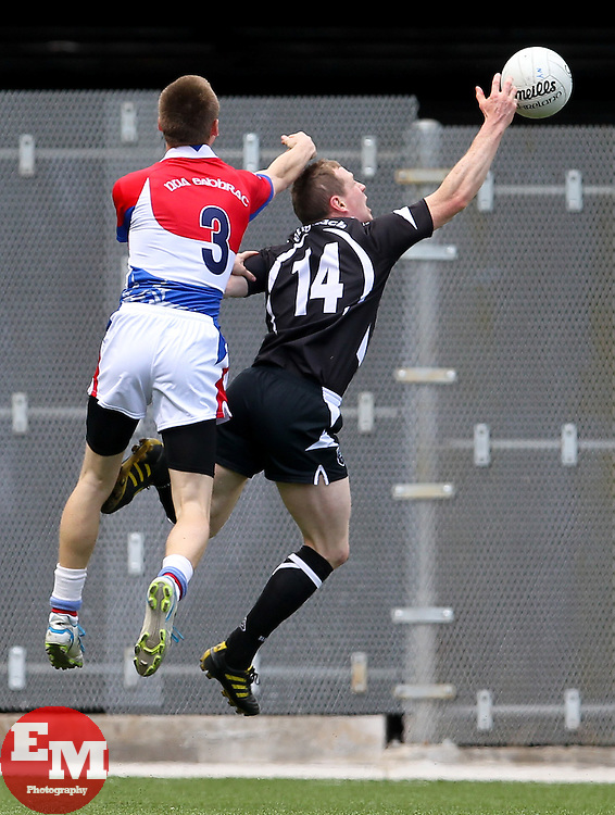 May 6, 2012; Bronx, NY; USA; Sligo's Adrian Marren tries to catch a pass while being defended by New York's Donnacha O'Dwyer during their game at Gaelic Park.
