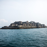 "NAGASAKI, JAPAN - AUGUST 8: Hashima Island, commonly known as Gunkanjima or ""Battleship Island"" in Nagasaki Prefecture, southern Japan on August 8, 2017. The island was a coal mining facility until its closure in 1974 is a symbol of the rapid industrialization of Japan, a reminder of its dark history as a site of forced labor during the Second World War. The island now is recognized as UNESCO's World Heritage sites of Japan's Meiji Industrial Revolution. (Photo: Richard Atrero de Guzman/NURPhoto)"