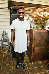 TINIE TEMPAH at the Warner Music Group Summer Party in association with British GQ held at Shoreditch House, Ebor Street, London E2 on 8th July 2015.
