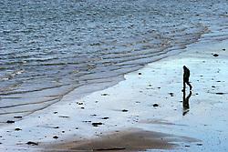 IRELAND KERRY DINGLE 6NOV05 - Lone man walks on the beach near Dingle Town on the same named Peninsula, Irelands most westerly county...jre/Photo by Jiri Rezac..© Jiri Rezac 2005..Contact: +44 (0) 7050 110 417.Mobile: +44 (0) 7801 337 683.Office: +44 (0) 20 8968 9635..Email: jiri@jirirezac.com.Web: www.jirirezac.com..© All images Jiri Rezac 2005 - All rights reserved.