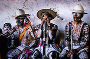 The Coras are a small Indigenous people living in the Sierra Madre mountains of the Mexican state of Nayarit. The Coras still follows their traditions, protecting in a strong way their secret rites that anthropologists believe amongst the most interesting of Latin America for their synchretism. The ceremonies for the Holy Week are characterized by impressive ceremonies. The Judios paints their bodies simbolysing the Evil forces and struggles in the streets of the villages looking for Jesus.