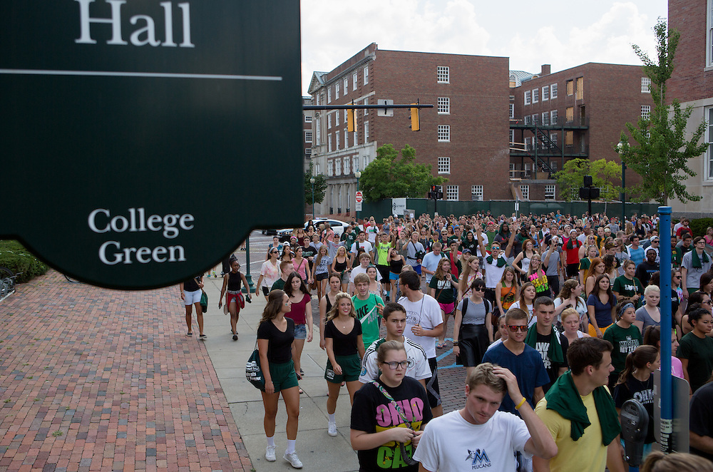 Led by the Marching 110, new students arrive at the College Green following the New Student Convocation on Aug. 24, 2014. Photo by Lauren Pond