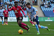 Coventry City defender Chris Stokes takes on Peterborough United midfielder Jermaine Anderson during the Sky Bet League 1 match between Coventry City and Peterborough United at the Ricoh Arena, Coventry, England on 31 October 2015. Photo by Alan Franklin.