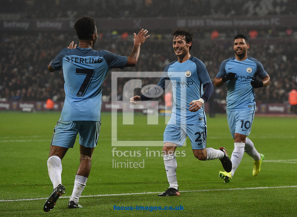 Manchester City's David Silva celebrates scoring their third goal with second goal scorer Raheem Sterling during the third round of the FA Cup at the London Stadium, Stratford<br /> Picture by Daniel Hambury/Focus Images Ltd 07813022858<br /> 06/01/2017