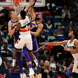 Mar 31, 2019; New Orleans, LA, USA; Los Angeles Lakers center Moritz Wagner (15) and center JaVale McGee (7) defend against New Orleans Pelicans guard Elfrid Payton (4) during the first quarter at the Smoothie King Center. Mandatory Credit: Derick E. Hingle-USA TODAY Sports