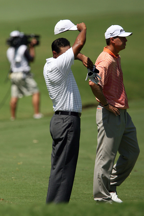 09 August 2007: Tiger Woods wipes his brow while playing in temperatures exceeding 100 degrees during the first round of the 89th PGA Championship at Southern Hills Country Club in Tulsa, OK.