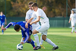 Aaron Sanchez of Andorra vs Rok Jazbec and Matic Reja of Slovenia during football game between Slovenia and Andorra of UEFA Under19 Championship Qualifications, on October 15, 2013 in Bakovci, Slovenia. (Photo by Erik Kavas / Sportida)