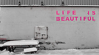 """Life is Beautiful"" painted in pink on a wall in Tromsø, Norway. Image taken with a Leica X2 camera (ISO 100, 24 mm, f/5, 1/50 sec). Raw image processed with Capture One Pro"