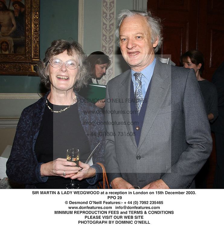 SIR MARTIN & LADY WEDGWOOD at a reception in London on 15th December 2003.<br /> PPO 29