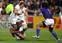 © Andrew Fosker / Seconds Left Images 2011 - South Africa's Pat Lambie is tackled as Samoa's Maurie Faasavalu comes in from the right - South Africa v Samoa - Rugby World Cup 2011 - North Harbour Stadium - Auckland - New Zealand - 30/09/2011 -  All rights reserved..